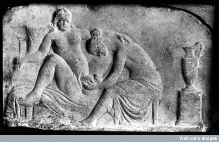 M0003964EB Ancient Roman relief carving of a midwife Credit: Wellcome Library, London. Wellcome Images images@wellcome.ac.uk http://wellcomeimages.org Ancient Roman relief carving of a midwife attending a woman giving birth. Published:  -  Copyrighted work available under Creative Commons Attribution only licence CC BY 4.0 http://creativecommons.org/licenses/by/4.0/